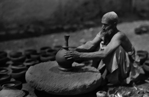 A man works at his potter's wheel